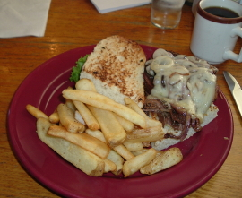 plate of steak fries and huge pot roast sandwich